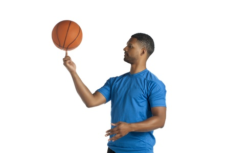 aieron: African American Man Spinning Basketball Stock Photo