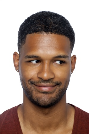 Close-up image of  African-American man with funny face looking to the side of a white surface photo