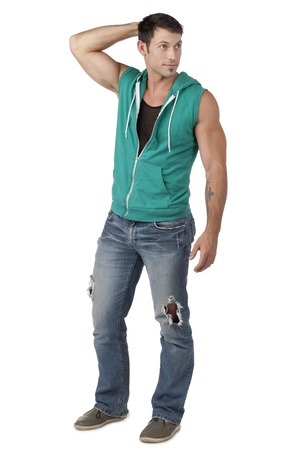 hooded vest: Portrait of muscular male model wearing sleeveless vest isolated on a white background Stock Photo