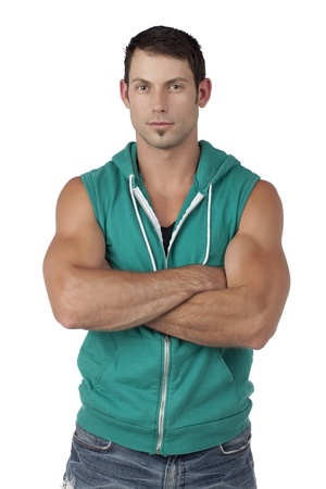 sleeveless hoodie: Portrait of muscular male model with arm crossed while smiling on a white surface Stock Photo