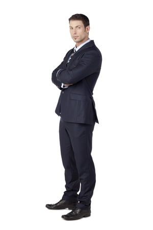 Professional businessman wearing business attire with crossed-arm photo