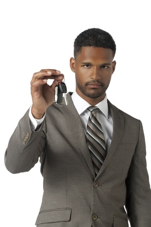 Portrait of promoted businessman holding a key isolated on white background Stock Photo - 17516052