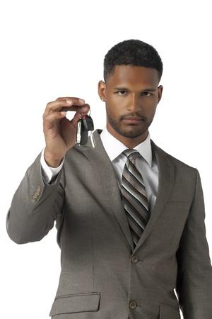 promoted: Portrait of promoted businessman holding a key isolated on white background