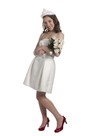 prom queen: Portrait of a prom queen with crown and flowers wearing white dress