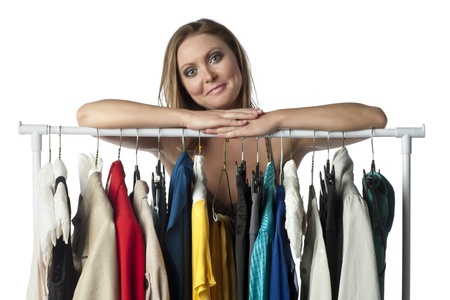 beauty shop: Portrait of a satisfied woman leaning on a clothes rack
