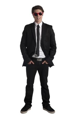 cute guy: Portrait of smiling cute teenage guy wearing sun glasses