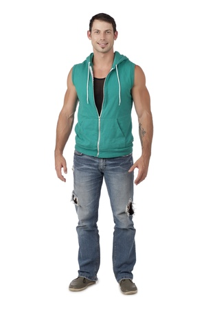 hooded vest: Portrait of smiling good looking man wearing green hooded vest standing against white background Stock Photo