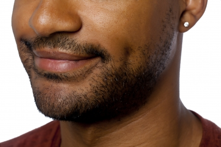 Close up image of smiling lips of African american guy