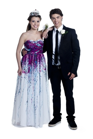 Portrait of smiling prom night couple against white background photo