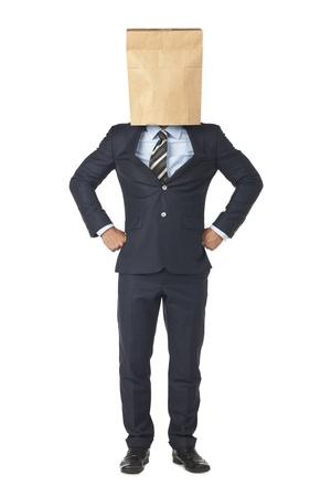 Businessman wearing a paper bag  photo