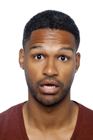 aieron: Closed up shot of surprised african-american man over a white background