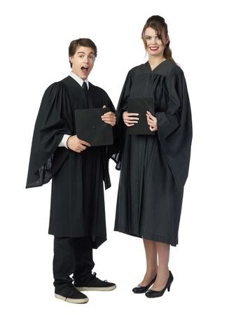 Portrait of two happy graduating students standing over the white surface Stock Photo - 17519620