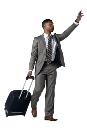 Isolated image of a business traveler waving his hand to call someone photo