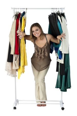 Portrait of woman with her dress collection against white background photo