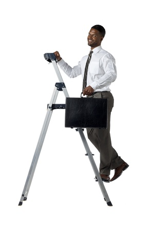 Portrait of a young businessman with briefcase climbing the stairs over the white background photo