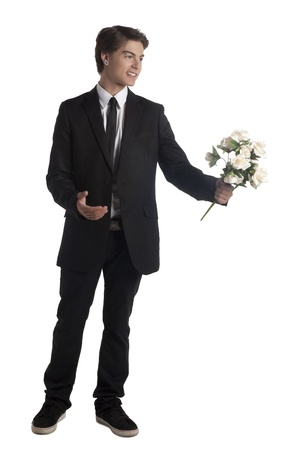 Portrait of young man giving a bouquet of flowers photo