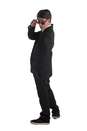 Standing young man is suit holding his shades Stock Photo - 17519326