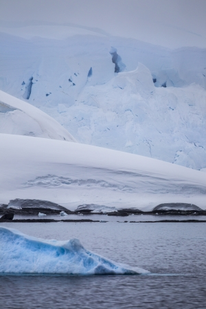 forground: Stock Photo of Iceberg in forground with massive formations in the background
