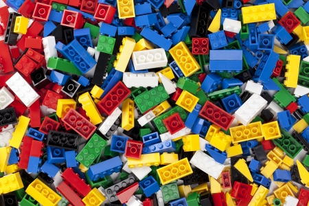 Horizontal image of assorted plastic toy bricks