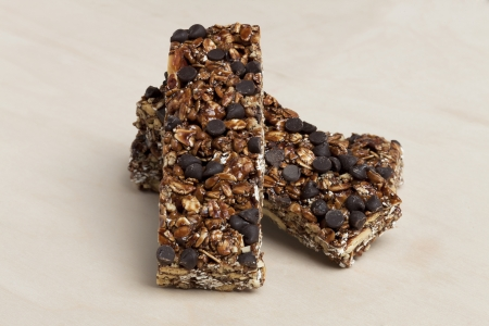 chewy: Close-up image of chewy granola bars on a wooden table Stock Photo