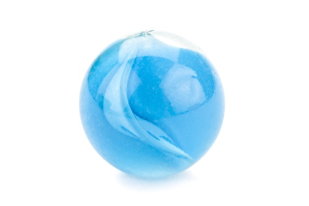 Close up image of blue glass marble against white background