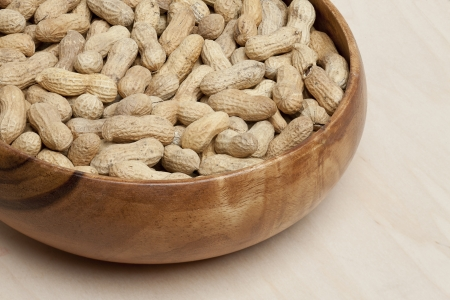 pygmy nuts: Close up image of a bowl of fresh peanuts on a table