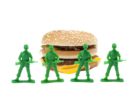 guarding: Image of a group of brave soldiers guarding the delicious hamburger on a white background