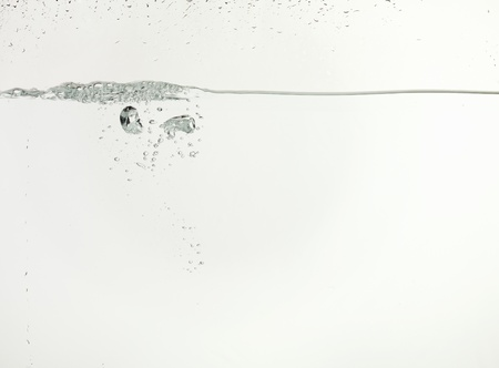 Image of a formation of bubbles on the clear water on a white background Zdjęcie Seryjne