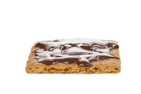 graham: Image of Graham crackers with chocolate syrup lying on a white surface