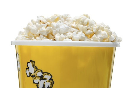Cropped close up image of bucket of popcorn against white background