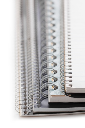 cropped image: Close-up cropped image of spiral notebooks on a white background Stock Photo
