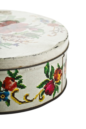 cropped image: Close-up cropped image of vintage decorative cookie tin isolated on a white background