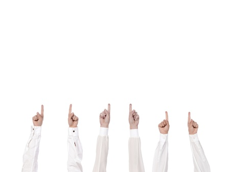 diverse people: Close up image of diverse people hands pointing up against white background