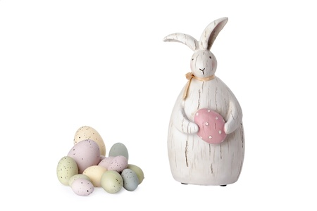 public celebratory event: Close up image of Easter bunny with colorful easter eggs against white background Stock Photo