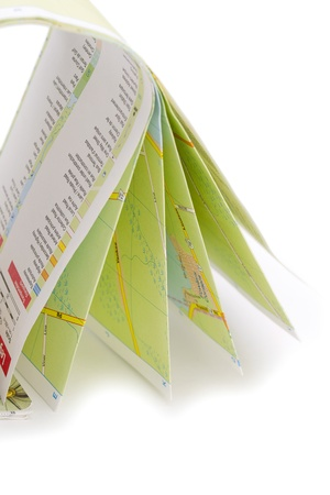 Folded atlas map over the white background