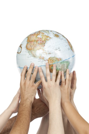 Group of hands lifting up the globe against the white background photo