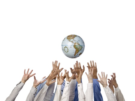 Multi-ethnic hands reaching out for the globe ball
