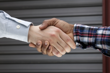 congratulating: Close-up image of humans hand congratulating each other after a closed door meeting