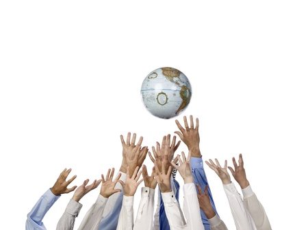 Image of various hands reaching world globe against white background photo