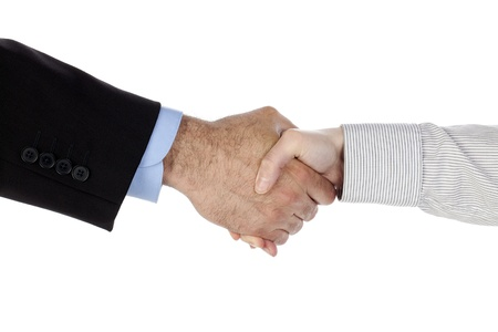 Horizontal image of man and woman's hand doing a handshake isolated in a white background