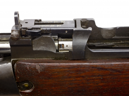 vintage riffle: Close up image of part of a rifle against white background