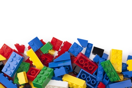 Close up image of pile of colorful blocks against white background