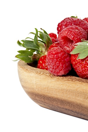 cropped image: Cropped image of red raspberries on a wooden container over the white background