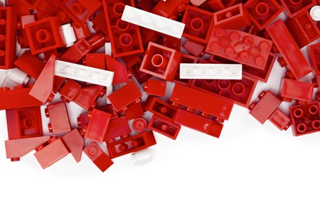 Image of a red and white lego bricks on a white background Foto de archivo