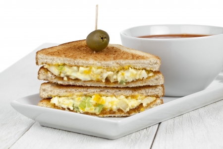 Horizontal image of a scrambled egg sandwich with pierced olive fruit and tomato soup bowl on  sc 1 st  123RF Stock Photo & Close Up Image Of An Egg Sandwich With Olive Fruit On A White ...
