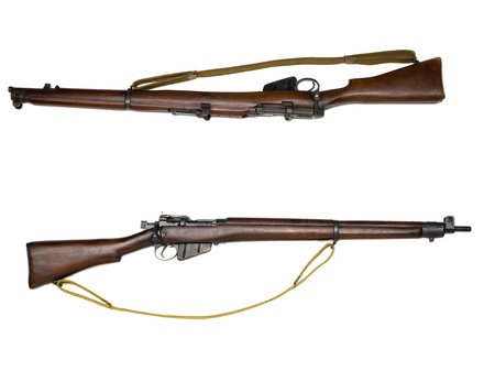 Horizontal image of two wooden old rifle isolated on a white background