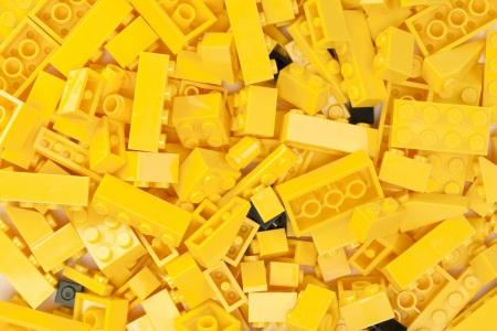 yellow lego block: Macro image of yellow bricks background