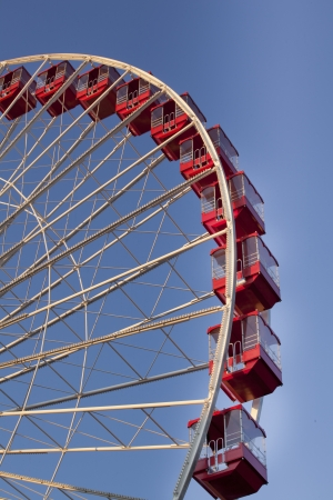 Cropped low angle view of ferris wheel against clear sky. photo