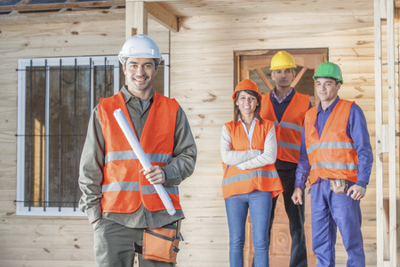 construction crew: 4 person construction crew at the construction site Stock Photo