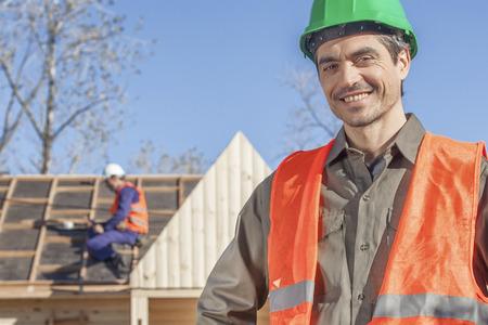 laborer: An orange vested laborer